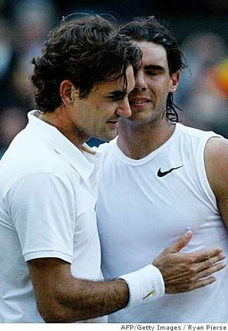 Spain's Rafael Nadal (R) is congratulated by Switzerland's Roger Federer after winning their final tennis match of the 2008 Wimbledon championships against  at The All England Tennis Club in southwest London, on July 6, 2008. Nadal won 6-4, 6-4, 6-7, 6-7, 9-7.     POOL  AFP PHOTO / RYAN PIERSE (Photo credit should read RYAN PIERSE/AFP/Getty Images) Photo: Ryan Pierse, AFP/Getty Images