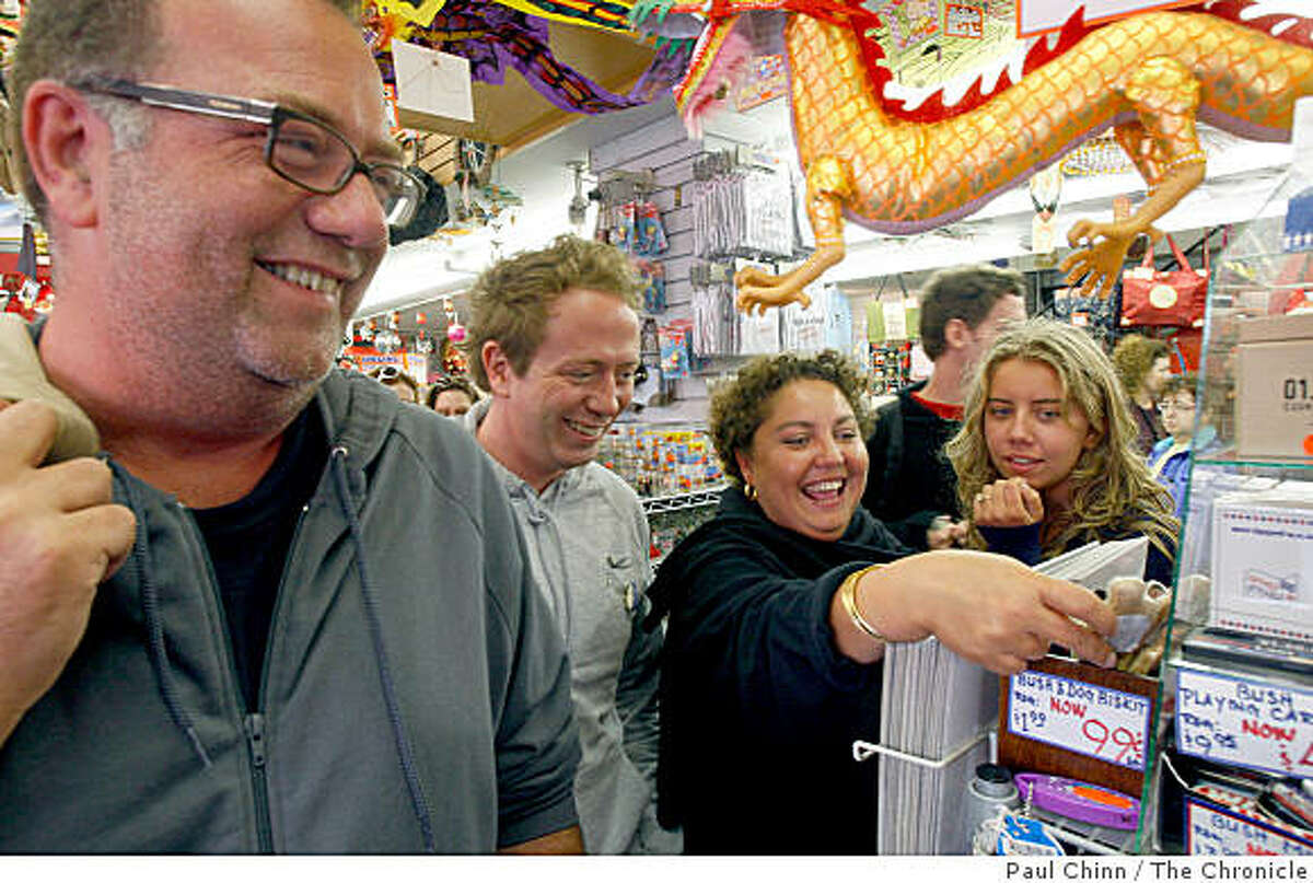 French tourists, from left, Bruno Icher, his brother Thomas, Bruno's wife Laure and daughter Margot go shopping in a Chinatown souvenir store in San Francisco, Calif., on Wednesday, Aug. 6, 2008. European tourists are flocking to San Francisco to take advantage of favorable exchange rates.