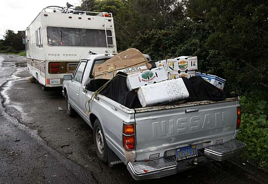 A pickup truck belonging to Bob Kaufman is filled with items and parked behind a motor home where Kaufman lives on Beatty Avenue just outside San Francisco city limits in Brisbane, Calif., on Friday, Jan. 22, 2010. Kaufman is caught in a legal battle over a number of vehicles he parks but never moves. Photo: Paul Chinn, The Chronicle