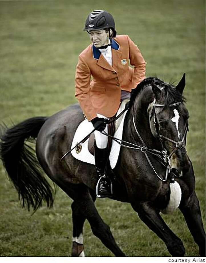 Red riding coat by Bay Area company, Ariat, to be worn by equestrian team at Beijing Summer Olympics 2008 -- pictured: Beezie Madden riding Photo: Courtesy Ariat