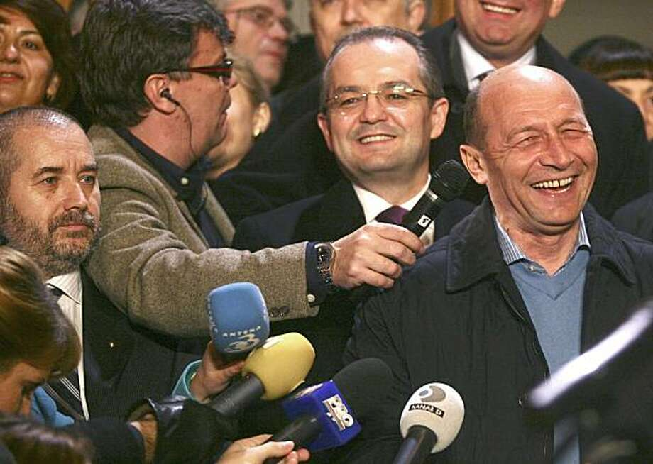In this Sunday, Dec. 6, 2009 photograph parapsychologist Aliodor Manolea, left, with beard, is seen next to Romania's President Traian Basescu, right. Manolea specialties include deep mind control, clairvoyance and hypnotic trance, according to the Romanian Association of Transpersonal Psychology. Photo: Octav Ganea, AP