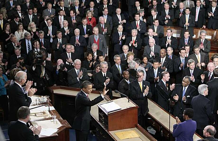 President Barack Obama waves before delivering his State of the Union address on Capitol Hill in Washington, Wednesday, Jan. 27, 2010. Photo: Pablo Martinez Monsivais, AP
