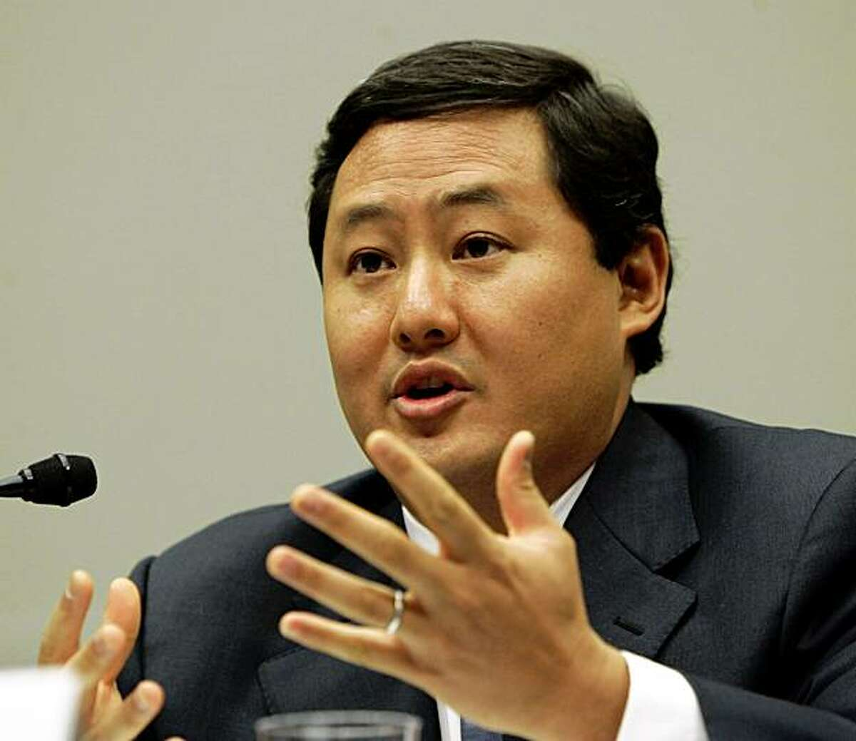 File - In this June 26, 2008 file photo John Yoo, a law professor at the University of California at Berkeley, testifies on Capitol Hill in Washington. Justice Department officials have stopped short of recommending criminal charges against Bush administration lawyers who wrote secret memos approving harsh interrogation techniques of terror suspects. (AP Photo/Susan Walsh, File)