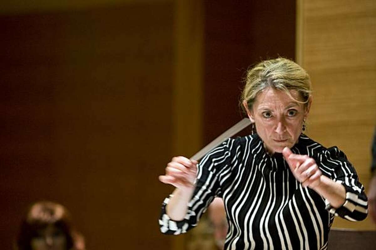 Conductor Nicole Paiement is all intensity as she directs the music during a stage rehearsal of Berg's opera, Wozzeck, at the San Francisco Conservatory of Music in San Francisco, Calif. on Friday, Jan. 15, 2010.