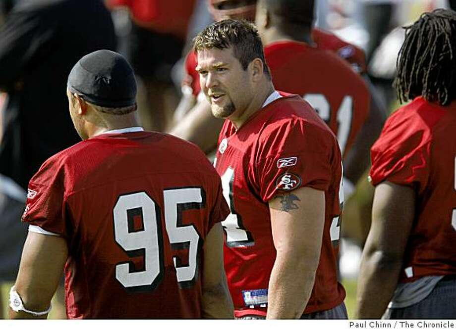 Defensive lineman Justin Smith talks with Tully Banta-Cain during training camp for the San Francisco 49ers in Santa Clara, Calif., on Friday, July 25, 2008.Photo by Paul Chinn / The Chronicle Photo: Paul Chinn, The Chronicle