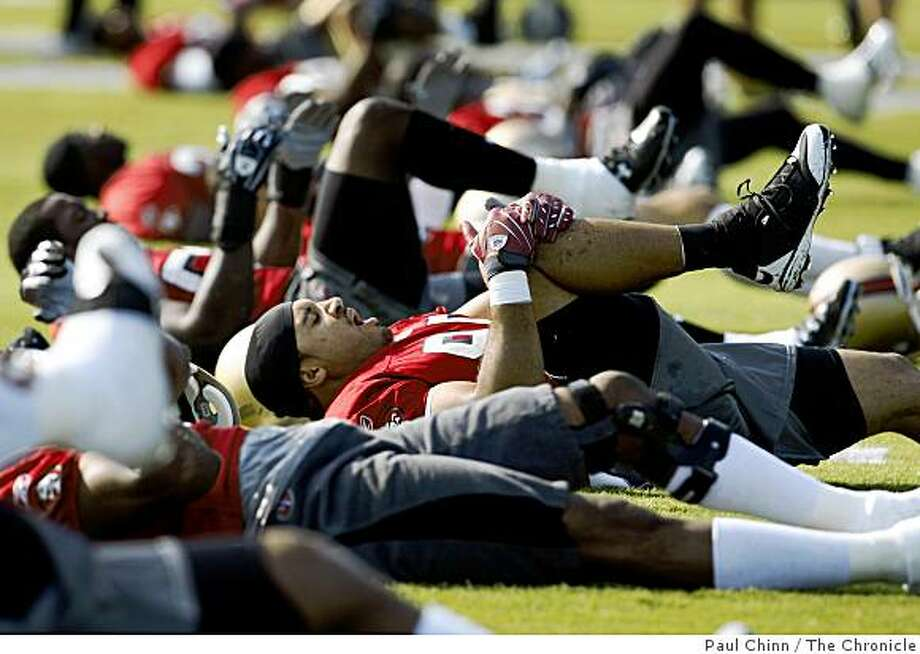 Linebacker Tully Banta-Cain stretches with teammates at the start of training camp for the San Francisco 49ers in Santa Clara, Calif., on Friday, July 25, 2008. Photo: Paul Chinn, The Chronicle