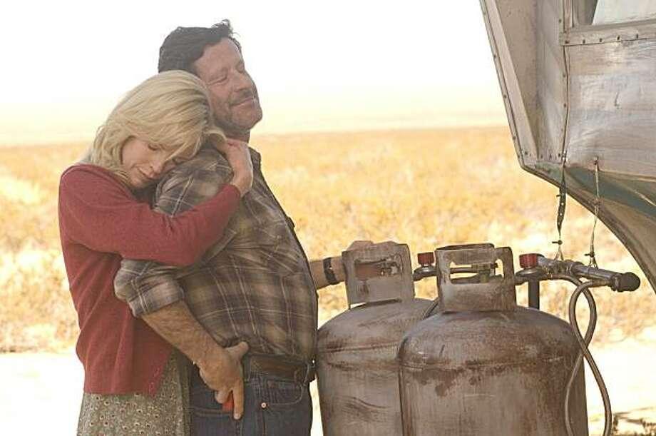 Kim Basinger and Joaquim de Almeida in THE BURNING PLAIN, a Magnolia Pictures release. Photo: Magnolia Pictures