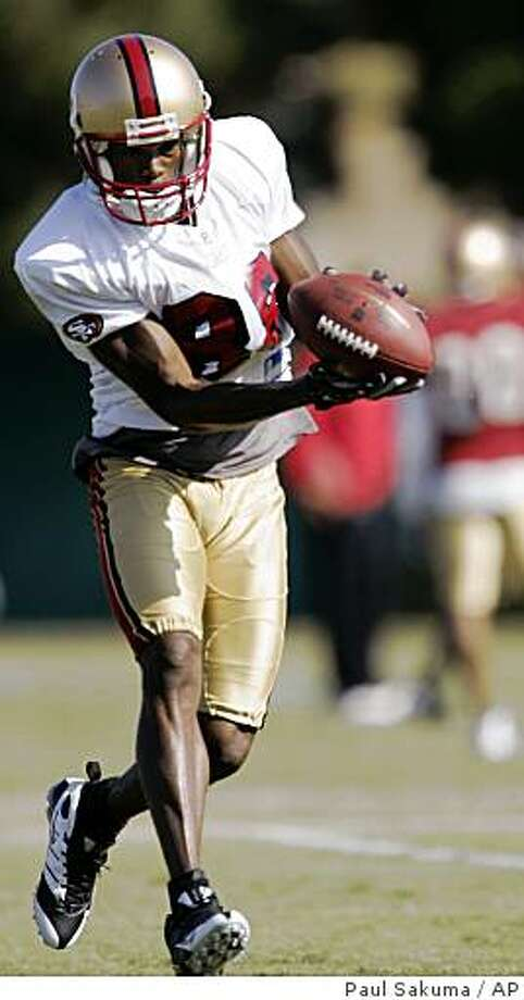 Isaac Bruce catches a pass during training camp at 49ers headquarters in Santa Clara, Calif., Tuesday, July 29, 2008. Associated Press photo by Paul Sakuma Photo: Paul Sakuma, AP