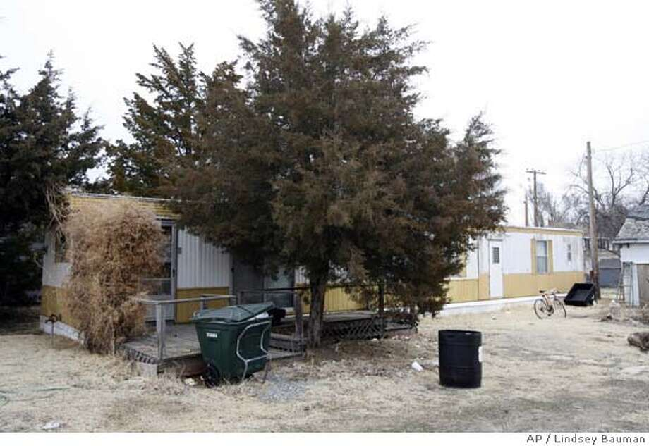 ###Live Caption:The home of Kory McFarren is pictured on Thursday, March 13, 2008, in Ness City, Kan., where the man's girlfriend was found in the bathroom having stayed there for long enough for her to become stuck to the toilet. (AP Photo/Lindsey Bauman)###Caption History:The home of Kory McFarren is pictured on Thursday, March 13, 2008, in Ness City, Kan., where the man's girlfriend was found in the bathroom having stayed there for long enough for her to become stuck to the toilet. (AP Photo/Lindsey Bauman)###Notes:###Special Instructions: Photo: Lindsey Bauman
