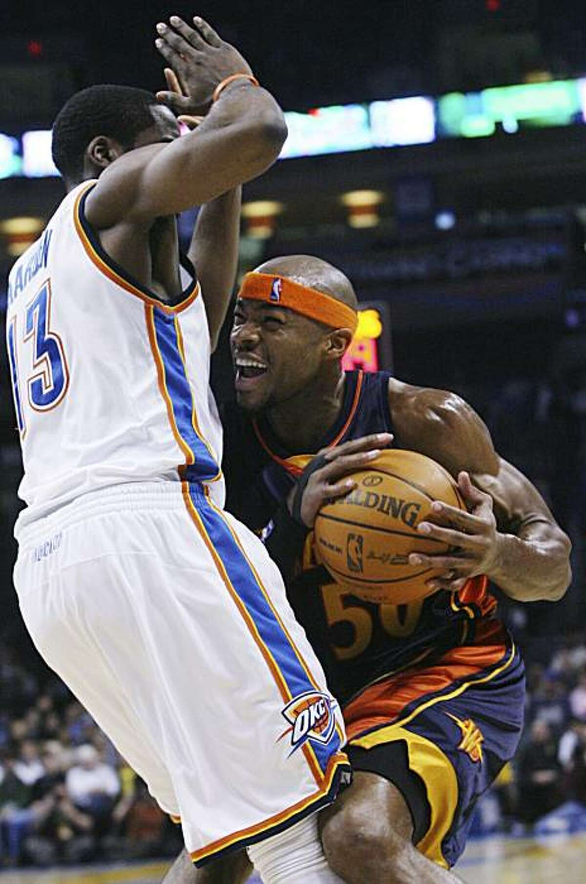 Golden State forward Corey Maggette, right, is fouled by Oklahoma City Thunder guard James Harden, left, in the first quarter of an NBA basketball game in Oklahoma City, Sunday, Jan. 31, 2010.