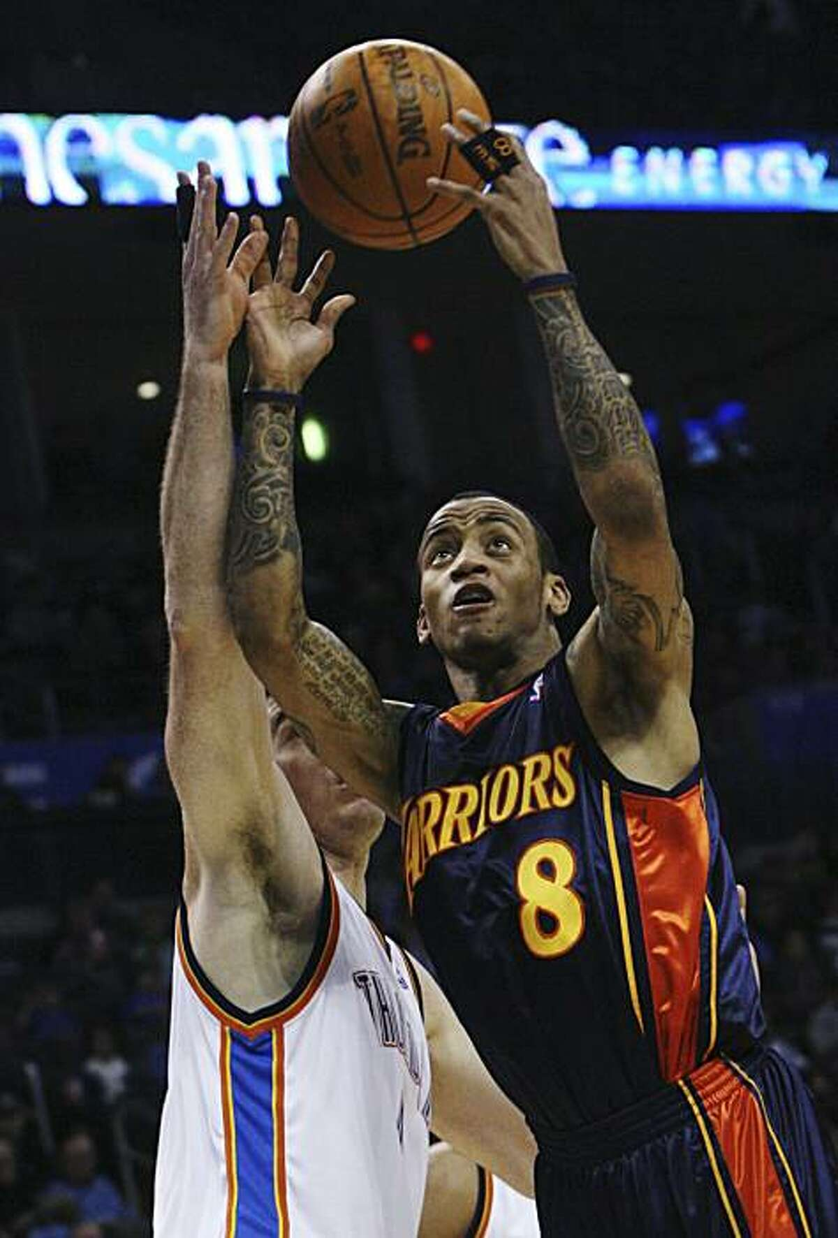 Golden State guard Monta Ellis, right, shoots in front of Oklahoma City Thunder forward Nick Collison, left, in the second quarter of an NBA basketball game in Oklahoma City, Sunday, Jan. 31, 2010. Ellis had 25 points for Golden State, but Oklahoma City won 112-104.
