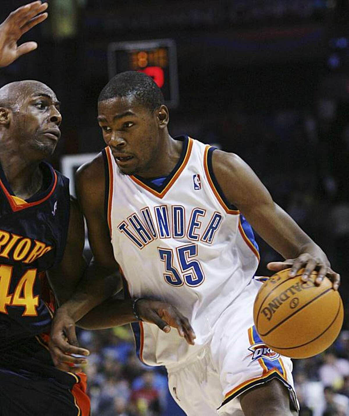 Oklahoma City Thunder forward Kevin Durant, right, drives around Golden State forward Anthony Tolliver, left, in the fourth quarter of an NBA basketball game in Oklahoma City, Sunday, Jan. 31, 2010. Oklahoma City won 112-104.