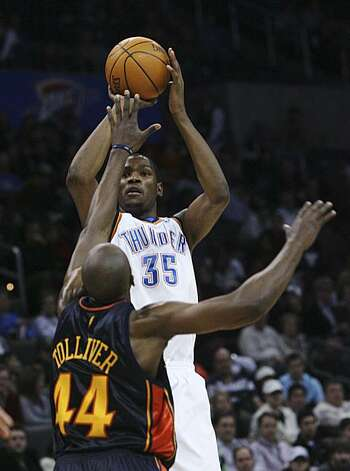 Oklahoma City Thunder forward Kevin Durant, right, shoots over Golden State forward Anthony Tolliver in the fourth quarter of an NBA basketball game in Oklahoma City, Sunday, Jan. 31, 2010. Durant had 45 points as Oklahoma City won 112-104. Photo: Sue Ogrocki, AP