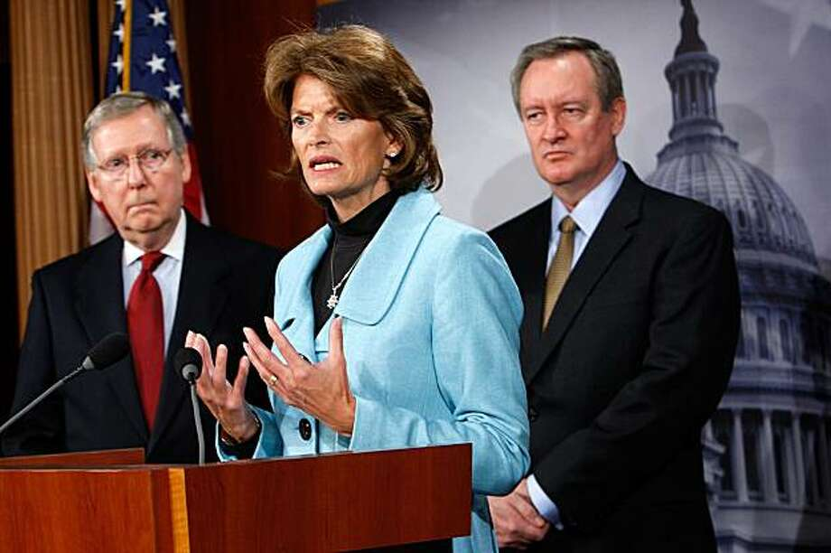 WASHINGTON - JANUARY 12:  U.S. Sen. Lisa Murkowski (R-AK) speaks as Senate Minority Leader Sen. Mitch McConnell (R-KY) (L) and Sen. Mike Crapo (R-ID) (R) listen during a news conference on Capitol Hill January 12, 2010 in Washington, DC. The Republican legislators briefed the media on a recent Congressional delegation to Afghanistan and Pakistan. Photo: Alex Wong, Getty Images