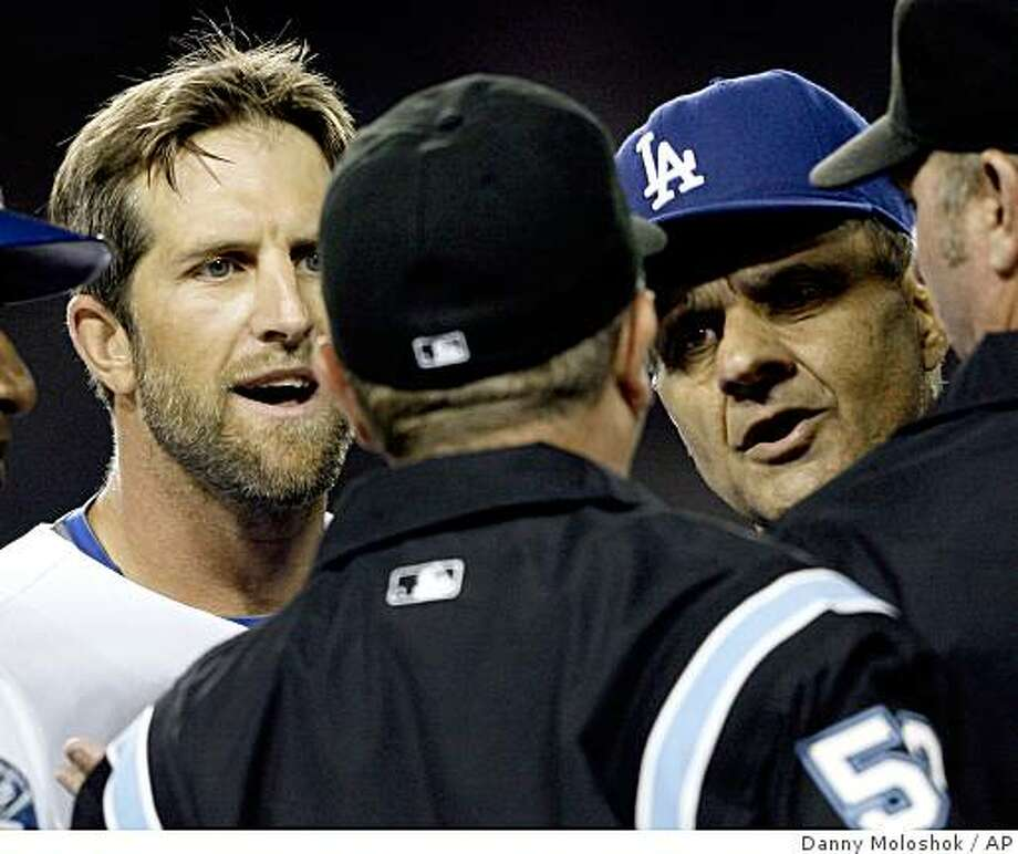 Los Angeles Dodgers' Casey Blake, left, and manager Joe Torre, right, argue with first base umpire Greg Gibson, center, after Blake was thrown out of the game during the eighth inning of a Major League Baseball game against the San Francisco Giants on Monday, July 28, 2008 in Los Angeles. Torre was thrown out of the game during the argument. (AP Photo/Danny Moloshok) Photo: Danny Moloshok, AP