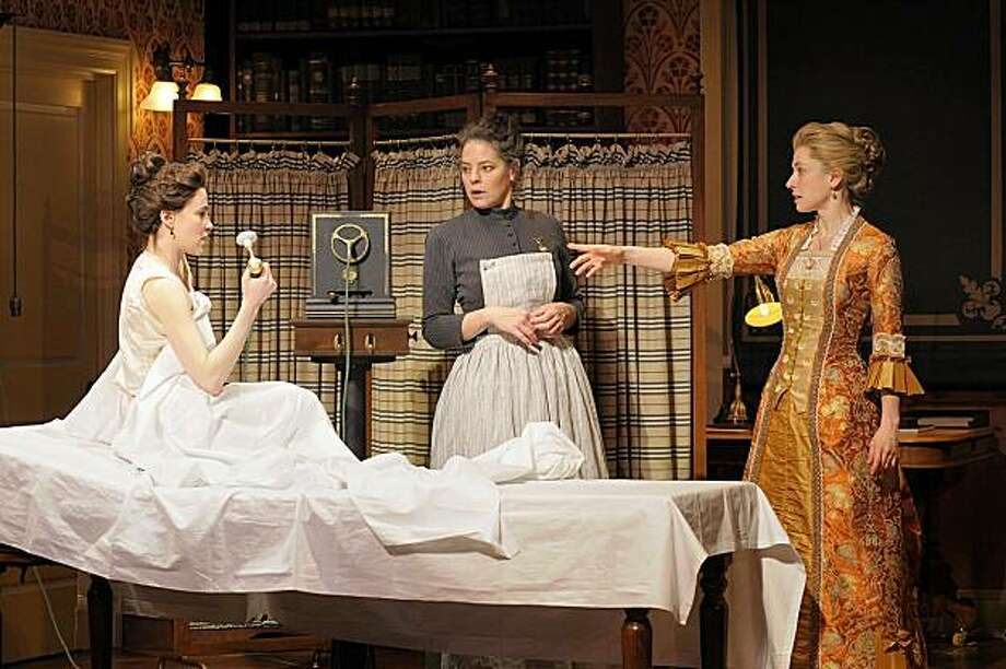 """Maria Dizzia (left), Stacy Ross and Hannah Cabell discuss a new medical marvel in """"In the Next Room (or the vibrator play)"""" at Berkeley Rep Theatre. Photo: Kevinberne.com"""