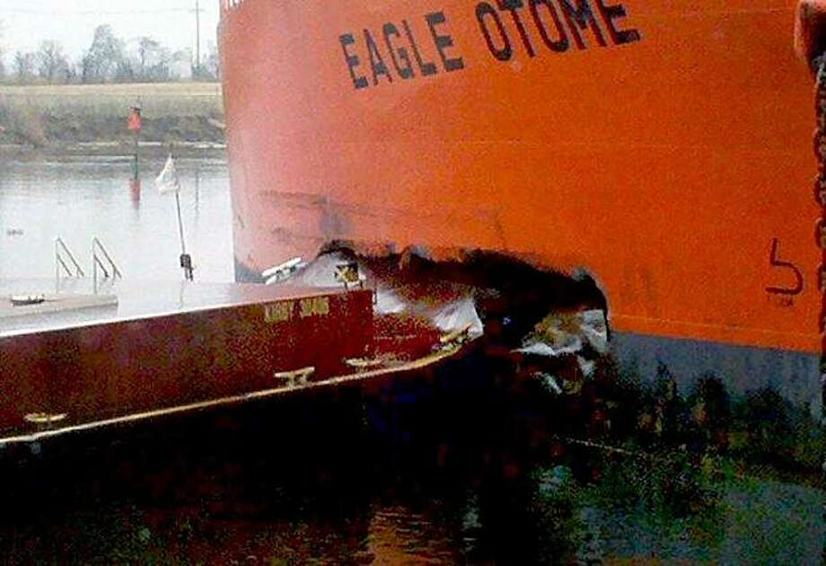 A gash in the side of the oil tanker Eagle Otome is seen after a collision Saturday morning, Jan. 23, 2010 in Port Arthur, Texas. As much as 450,000 gallons of crude oil spilled in a southeast Texas port Saturday after two vessels collided, the U.S. CoastGuard said. No injuries have been reported, but part of the port has been closed and some nearby residents have been evacuated. Photo: Reesha Brown, AP