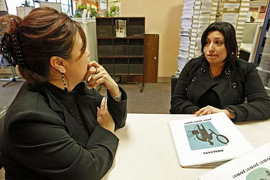 In this photo taken on Wednesday, Dec. 30, 2009, former co-workers, Marianna Carrillo, left, an accounting assistant, and Georgina Leyva, right, a marketing assistant, look for new jobs, after they were laid off just three hours prior from a financial firm, at the Verdugo Job Center  in Glendale, Calif. The economy lost more jobs in December and the unemployment rate was unchanged, as a sluggish economic recovery has yet to revive hiring among the nation's employers. Photo: Damian Dovarganes, AP