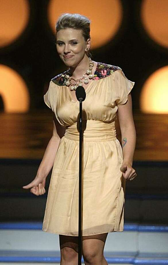 Actress Scarlett Johansson presents the Do Something Choice on stage at the Teen Choice Awards in Universal City, Calif., on Sunday, Aug. 3, 2008. (AP Photo/ Chris Carlson) Photo: Chris Carlson, AP