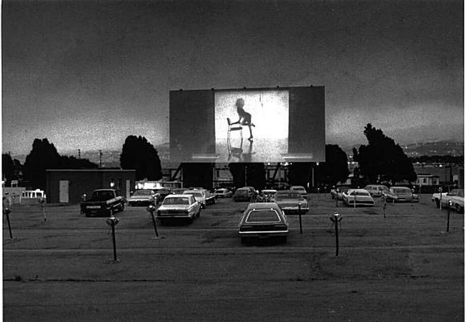 The Spruce Drive-In Theater in South San Francisco in 1983.  Movie on screen is Flashdance. Photo: Chris Stewart, The Chronicle
