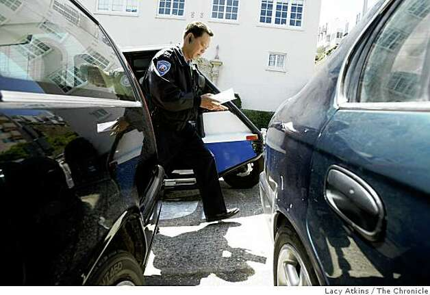 Parking control officer Joe Raquiza tickets a car parked in the North Beach area, Thursday July 31, 2008 , in San Francisco, Calif. Photo by Lacy Atkins /The Chronicle Photo: Lacy Atkins, The Chronicle