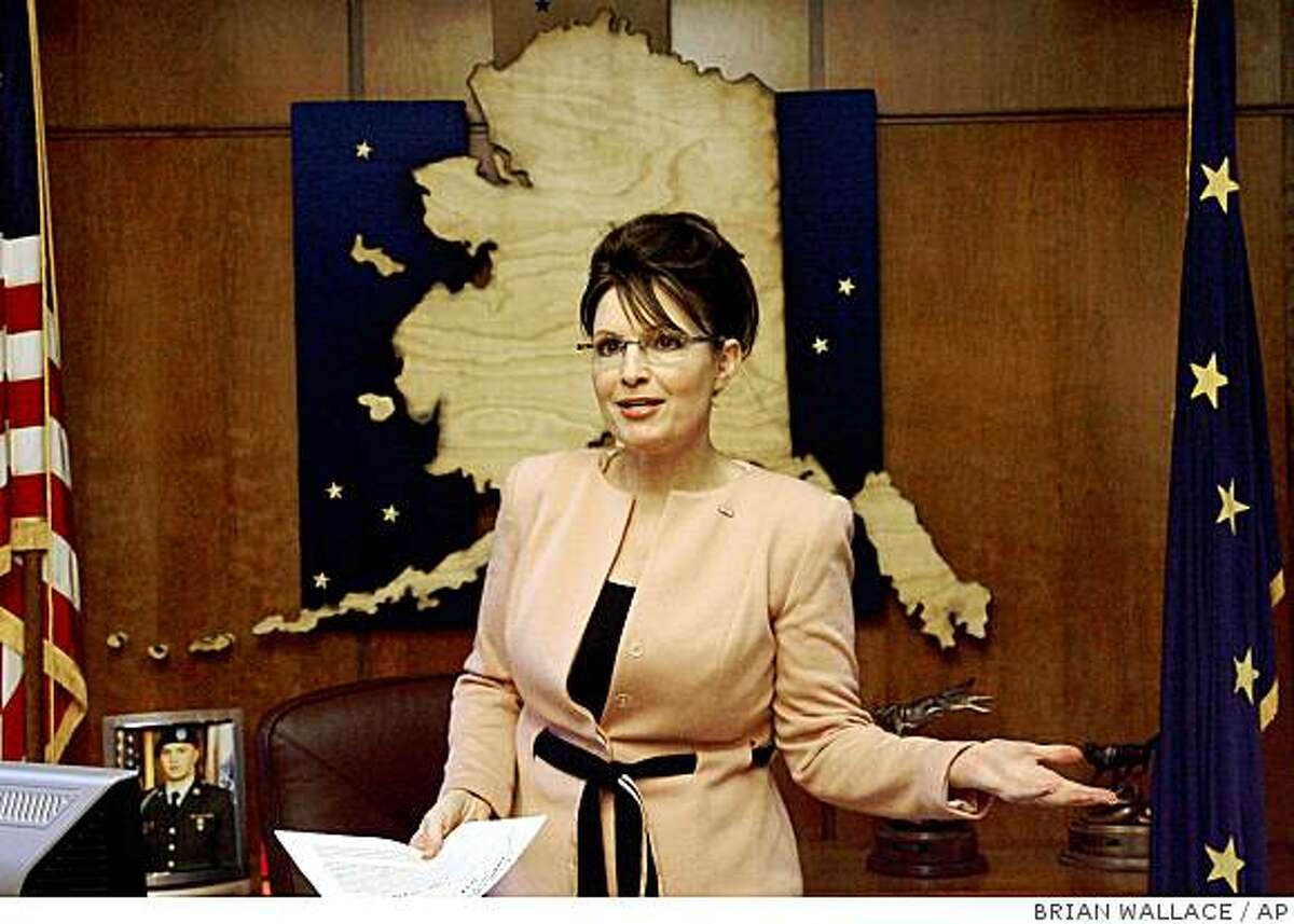 Gov. Sarah Palin speaks to reporters regarding the indictment of U.S. Sen Ted Stevens in her Capitol office in Juneau, Alaska Tuesday July 29, 2008. (AP Photo/Juneau Empire, Brian Wallace)