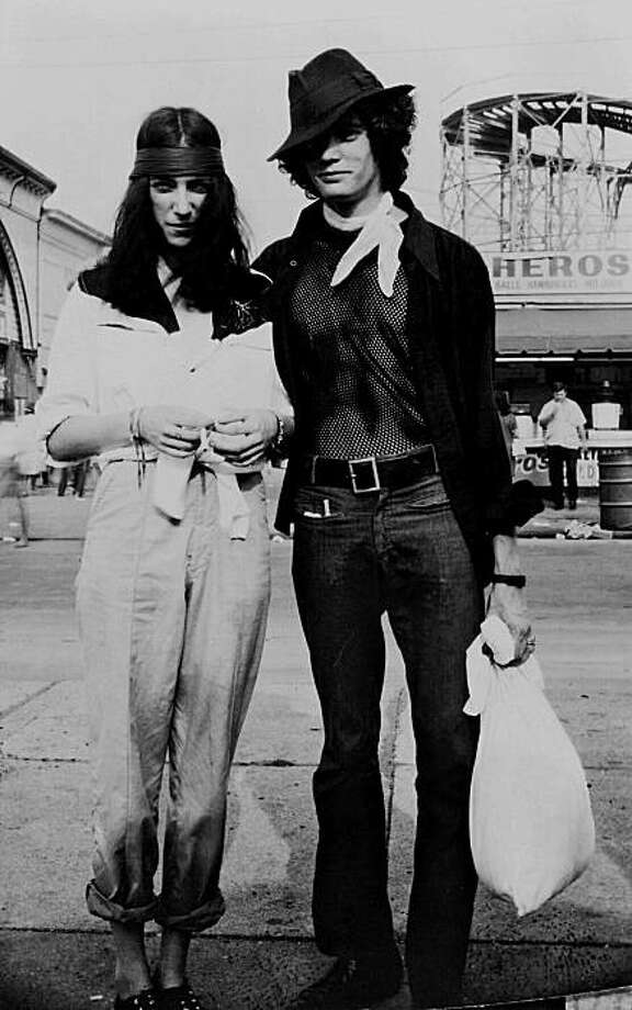 Patti Smith and Robert Mapplethorpe, Coney Island boardwalk, September 1, 1969, please credit to 'Courtesy of the Patti Smith Archive' Photo:  Patti Smith Archive