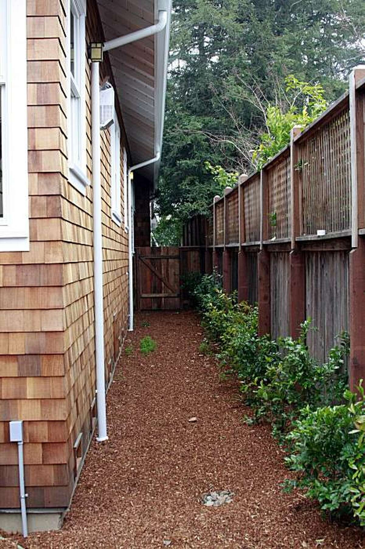 Side yard access is an area connecting one side of a house or other building, like the one at this San Rafael home.