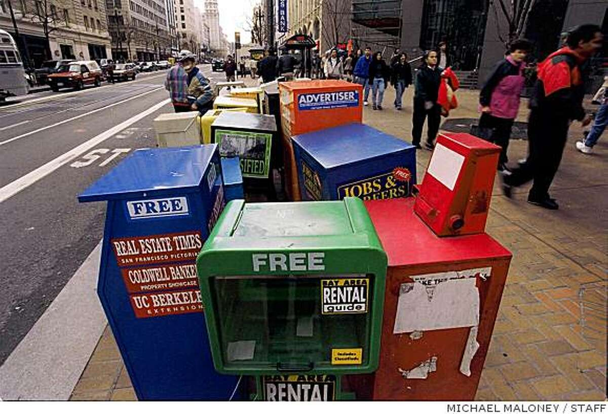 NEWSRACKS 3/C/03MAR97/CD/MJM, NEWS BOXES IN VARIOUS STATES OF REPAIR LINE THE SIDEWALK ALONG THE 300 BLOCK OF MARKET STREET.ALSO RAN: 6/15/98