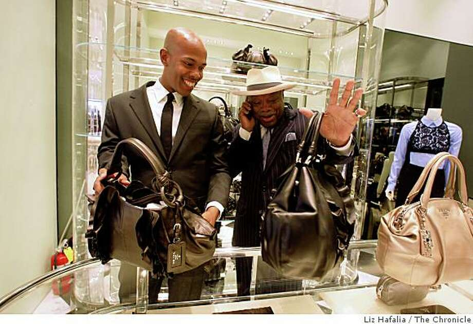 The new Prada store opens in July, 2008. A salesman shows former San Francisco mayor Willie Brown (right) women's bags at the new Prada in Union Square in San Francisco, Calif., on Monday, July 21, 2008, before it opens this Thursday. Photo by Liz Hafalia/The Chronicle Photo: Liz Hafalia, The Chronicle