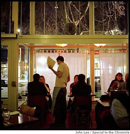 A server waits on diners in the main dining room of Pizzaiolo in Oakland. Photo: John Lee, Special To The Chronicle