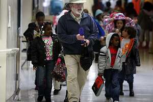 Second grade teacher Sam Frankel leads his students back to the classroom after lunch at the Berkeley Arts Magnet school in Berkeley, Calif., on Thursday, Jan. 21, 2010. Many employees, like Frankel, who work in the public sector after a previous career in the private sector, are finding their Social Security benefits are reduced because of their pension.