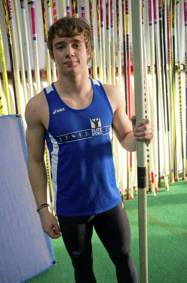 SPORTS; TRK PADALECKI E CENTRAL JMS; 02/08/12 East Central High School senior pole vault standout Kyle Padalecki poses for a portrait as he works out under the supervision of coaches Glen Dickson and daughter Brookelyn Dickson at the Elite Sportz San Antonio Pole Vault Complex in St. Hedwig, Texas, Wednesday, February 8, 2012. Photo: J. Michael Short , J. MICHAEL SHORT / THE SAN ANTONIO EXPRESS-NEWS
