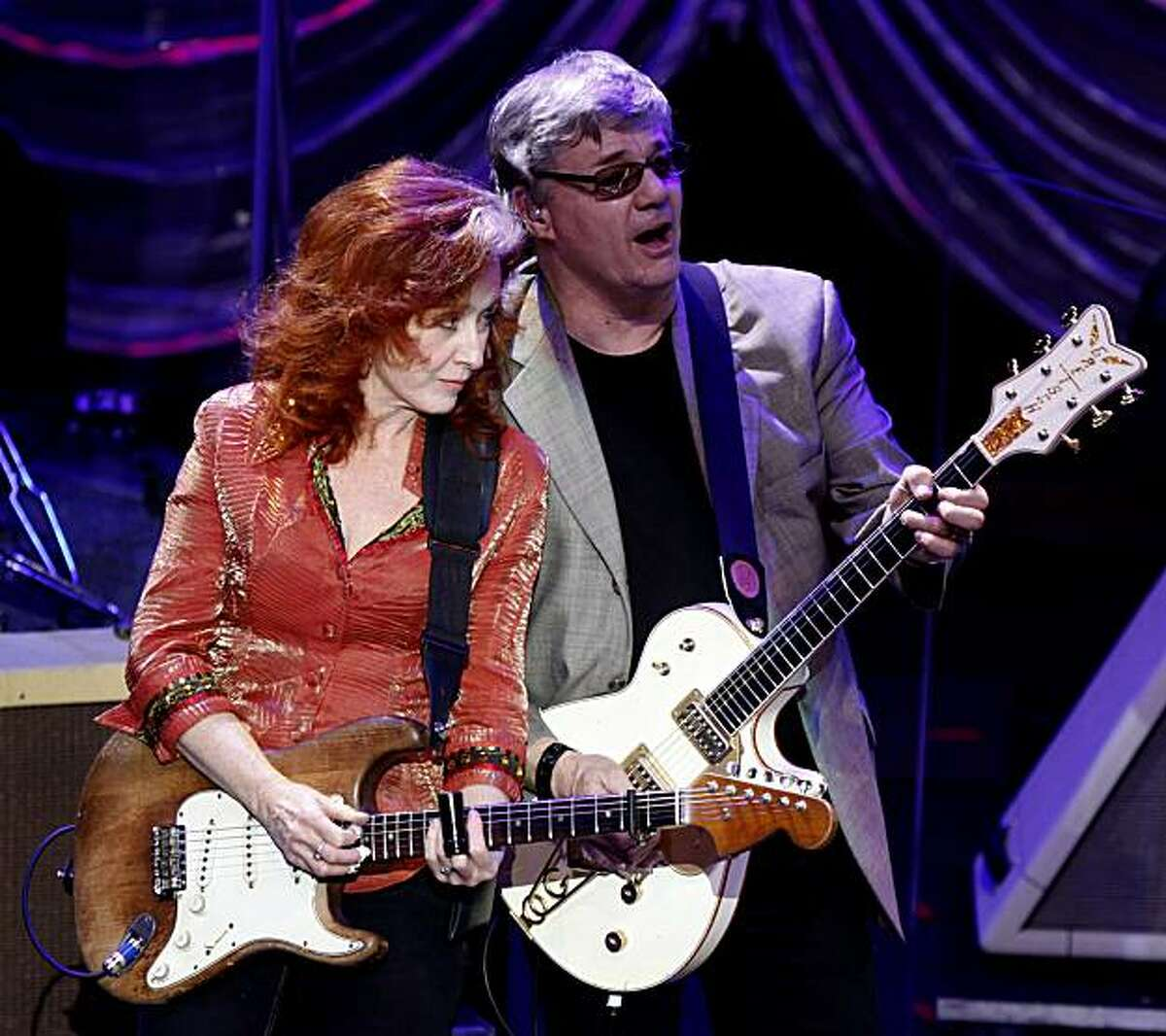 Steve Miller from the Steve Miller Band performs with Bonnie Raitt at the Fox Theater in downtown Oakland during a tribute concert for the late Bay Area harmonic legend Norton Buffalo. By Lance Iversen/The Chronicle