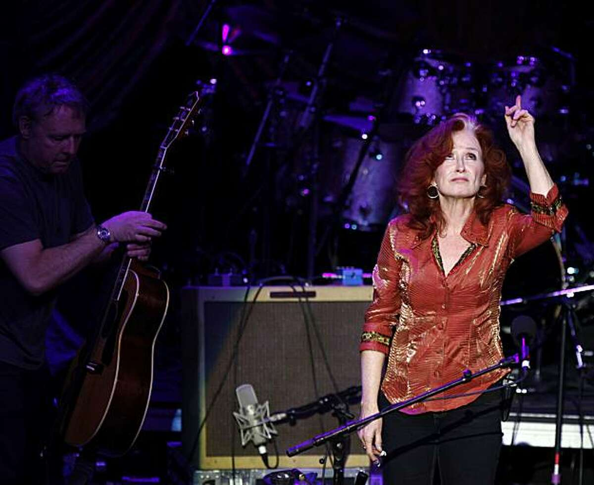 Bonnie Raitt points to the heavens as she and Steve Miller from the Steve Miller Band along with Doobie Bros performed in a tribute concert for the late Bay Area harmonic legend Norton Buffalo Saturday night Jan 23, 2010 at the Fox Theater in downtown Oakland By Lance Iversen/The Chronicle