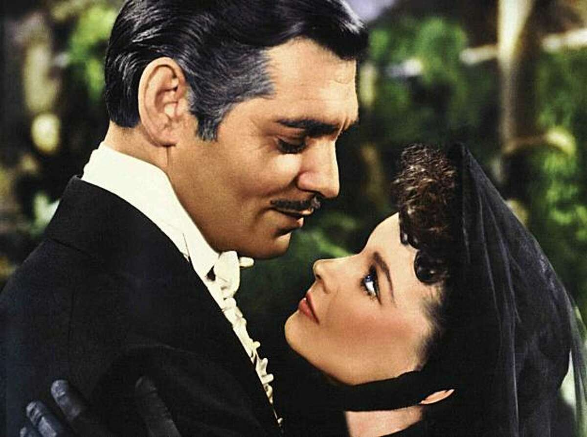 """MOVIE, FILM """"GONE WITH THE WIND' CAST INCLUDES: Clark Gable as Rhett Butler and Vivian Leigh as Scarlett O'Hare in """"Gone With the Wind."""""""