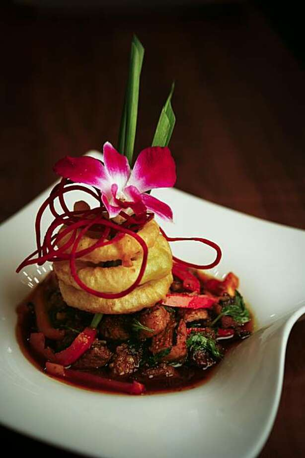 Volcanic Beef is Osha Thai Restaurant's signature dish.  Sisters Laita Souksamlane and Wassana Korkhieola opened their first Osha Thai Restaurant in 1996.  They will be opening their seventh location next week. Photo: Russell Yip, The Chronicle