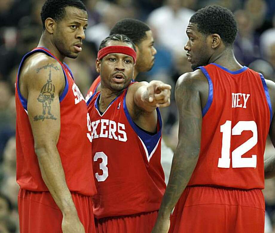 Philadelphia 76ers guard Allen Iverson, center, gives some pointers to Andre Iguodala, left, and Royal Ivey, right, during a time out in the second half of an NBA basketball game against the Sacramento Kings in Sacramento, Calif., Wednesday, Dec. 30, 2009. The 76ers won 116-106.(AP Photo/Steve Yeater) Photo: Steve Yeater, AP