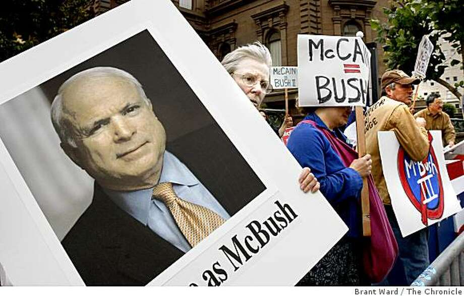 Gabie Berliner of San Francisco rested after holding up a large photograph of Senator McCain as she demonstrated against him outside the Fairmont Hotel. Presumed Republican nominee for President, Senator John McCain appeared at a private fundraiser at the Fairmont Hotel Monday evening which brought out about 200 protesters.  Photo by Brant Ward / The Chronicle Photo: Brant Ward, The Chronicle