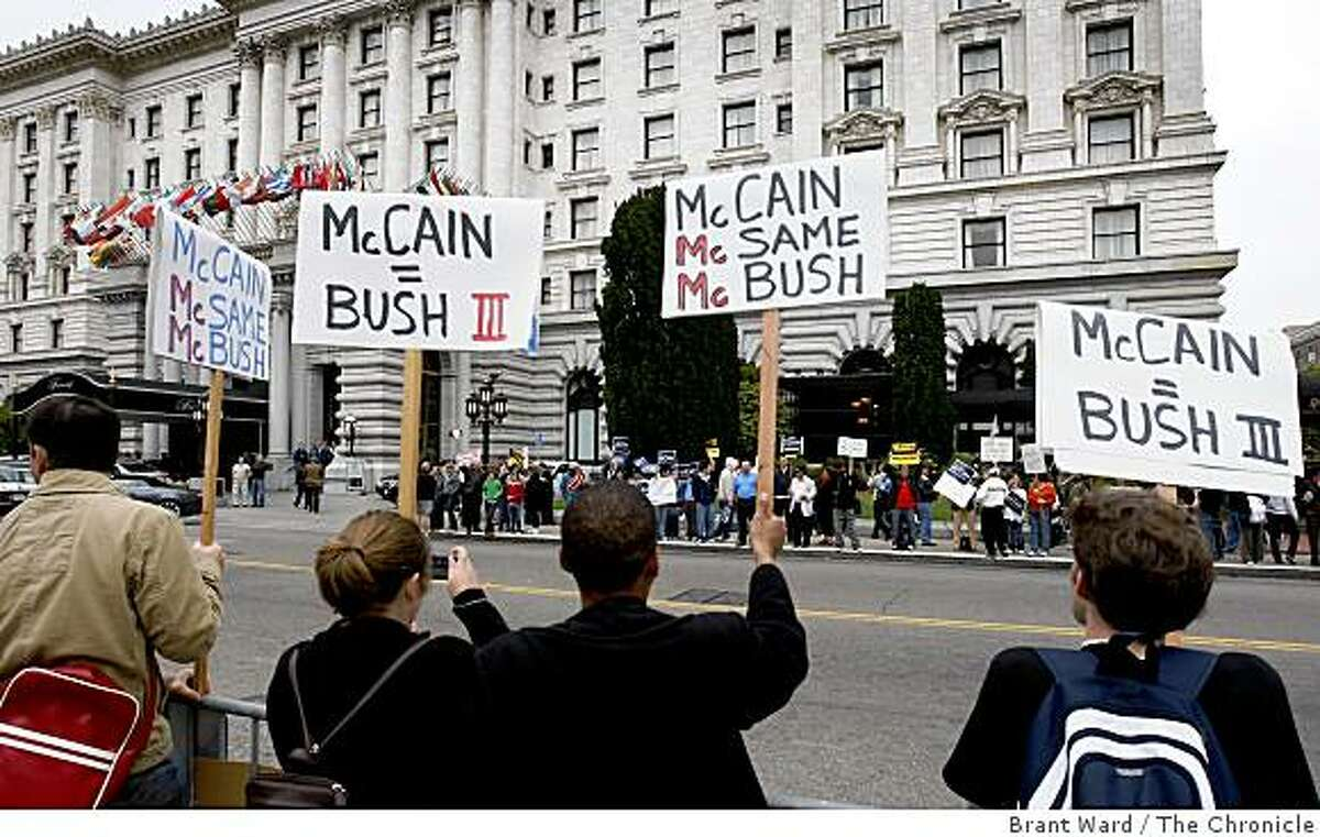Protesters stood across the street from the Fairmont Hotel in San Francisco where Sen. John McCain attended a private fundraiser. Photo by Brant Ward / The Chronicle