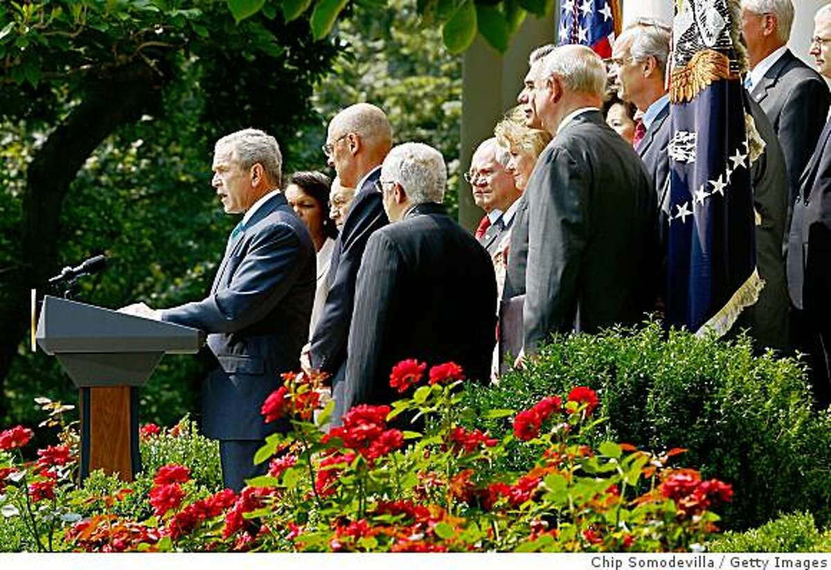 WASHINGTON - JULY 30: U.S. President George W. Bush (L) makes a statement with members of his Cabinet in the Rose Garden at the White House July 30, 2008 in Washington, DC. Bush demanded that Congress lift the ban on off-shore oil exploration of the outer continental shelf before taking their summer recess. (Photo by Chip Somodevilla/Getty Images)