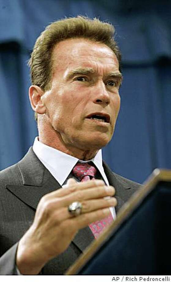 Gov. Arnold Schwarzenegger  answers questions after declaring a statewide drought and signing an executive order directing the Department of Water Resources to help speed water transfers to areas with the worst shortages, during a news conference at the Capitol in Sacramento, Calif., Wednesday, June 4, 2008.  Schwarzenegger made the drought declaration because the state has had two years of below-average rainfall, and low snow melt runoff.(AP Photo/Rich Pedroncelli) Photo: Rich Pedroncelli, AP