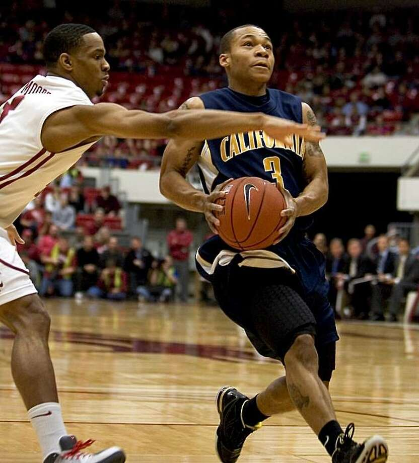 California guard Jerome Randale (3) drives to the basket as he is fouled by Washington State guard Reggie Moore, left, during the first half of an NCAA college basketball game Thursday, Jan. 14, 2010 at Beasley Coliseum in Pullman, Wash. Randle had a career high 39 points to pace California's 93-88 victory. Photo: Dean Hare, AP