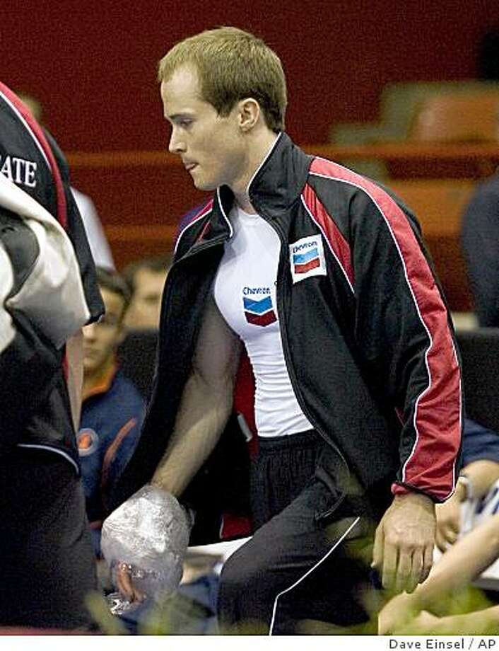 Paul Hamm leaves the floor with his hand wrapped in ice after injuring his wrist while competing on the parallel bars during the first round of the US gymnastics championships Thursday May 22, 2008 in Houston. Photo: Dave Einsel, AP
