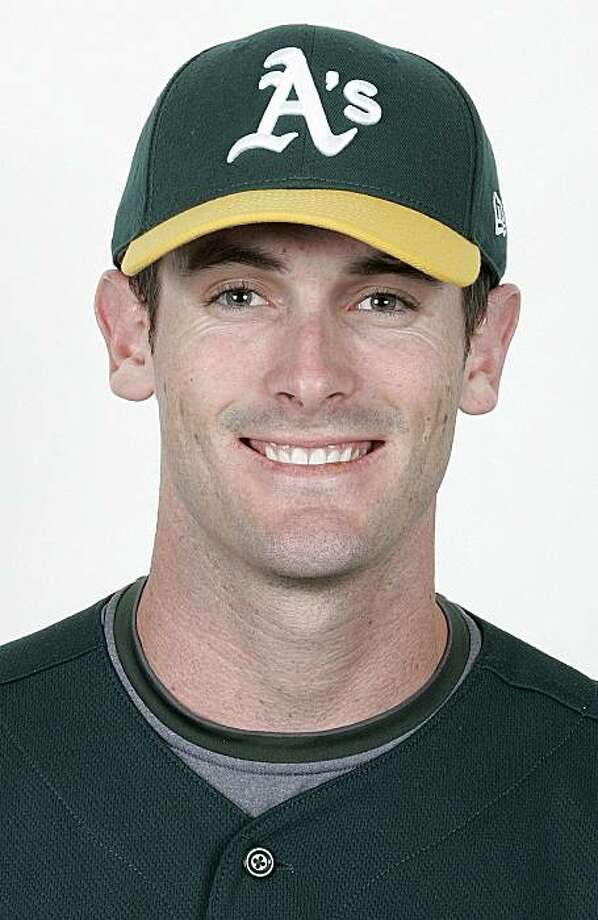 In this undated handout photo released by the Oakland Athletics, baseball player Grant Desme is shown. Oakland Athletics prospect Grant Desme is retiring from baseball to enter the priesthood, Desme announced on Friday, Jan. 22, 2010.  Desme plans to enter a seminary in August and hopes eventually to become a Catholic priest  Desme was selected the 2009 Arizona Fall League MVP and was considered one of the top prospects in Oakland's system. Photo: AP