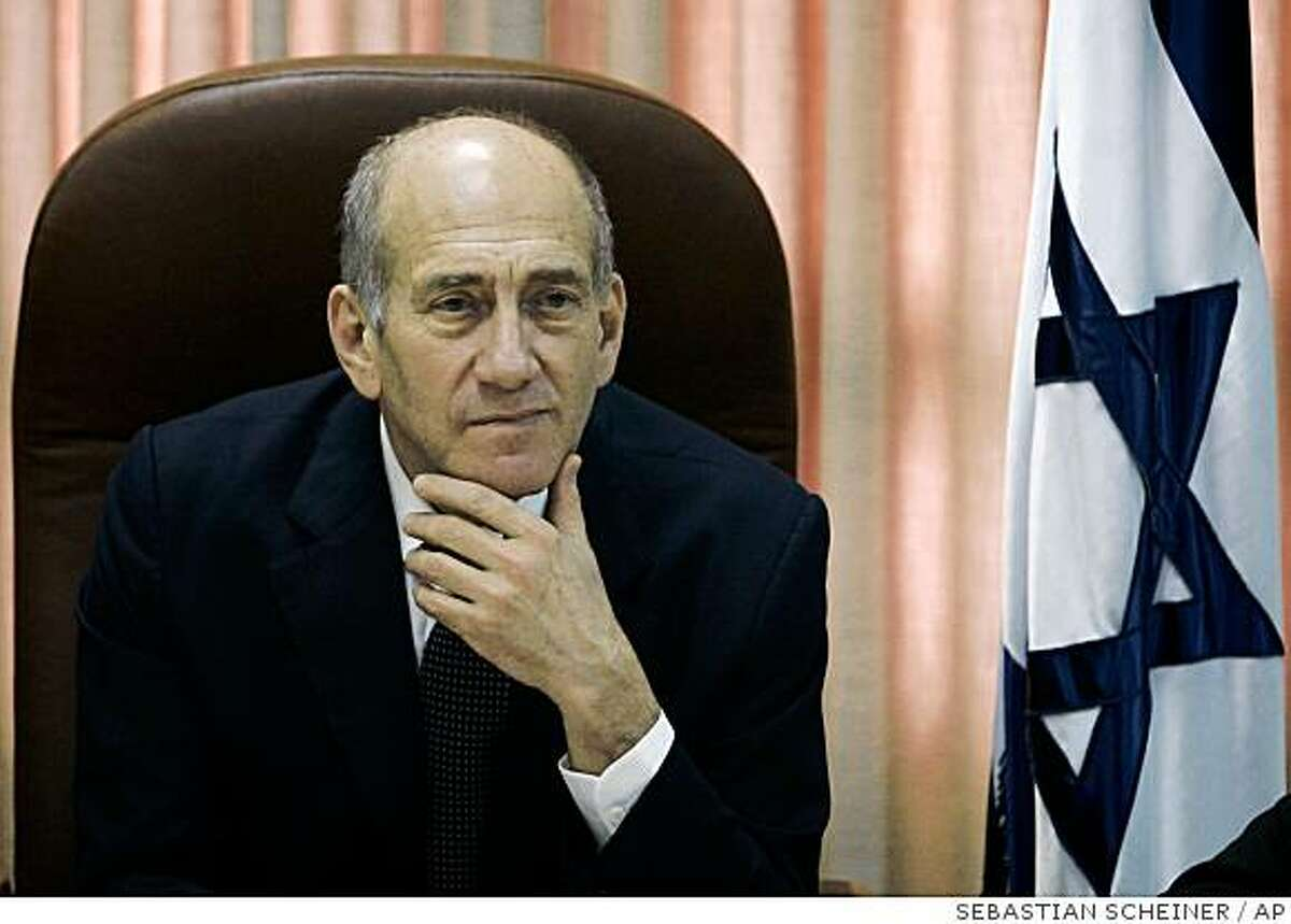 Israeli Prime Minister Ehud Olmert attends a meeting of his Kadima party at the Knesset, Israel's parliament in Jerusalem, Monday, July 28, 2008. Olmert said Monday he does not believe his government and the Palestinian leadership will be able to achieve their stated goal of a forging a peace deal by the end of the year, citing conflicting claims to Jerusalem as the main obstacle. (AP Photo/Sebastian Scheiner)