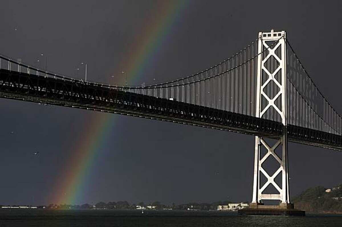 The San Francisco Bay Area was bombarded by storms Tuesday but during a brief respite, was graced by a rainbow that touched down at Treasure Island.