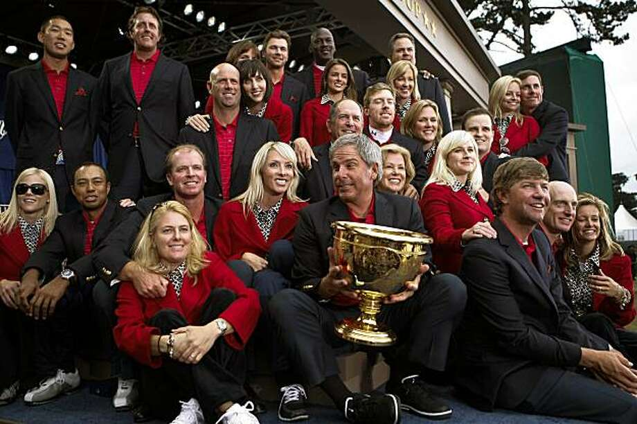 The U.S. team and their wives celebrate a Presidents Cup win Sunday at Harding Park in San Francisco. Photo: Michael Macor, The Chronicle