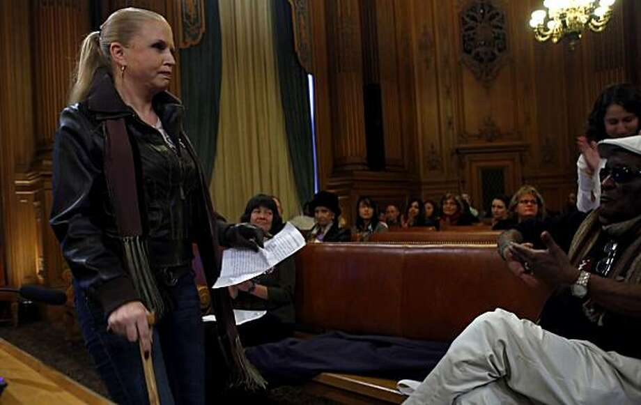 Kimberley Celoni , a patient at the Trauma Recovery Center, is applauded after testifying in front of the Board of Supervisors asking to keep the centers doors open, Wednesday Jan. 20, 2010, in San Francisco, Calif. Photo: Lacy Atkins, The Chronicle