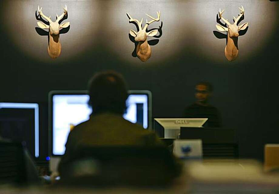 Three stag heads adorn a wall in the new Twitter offices seen in San Francisco, Calif. on Wednesday, Dec. 16, 2009. Photo: Russell Yip, The Chronicle
